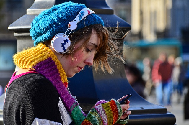 A girl listening from headphones